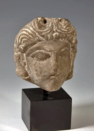 153: A Coptic Limestone Head of a Woman, ex Sotheby's