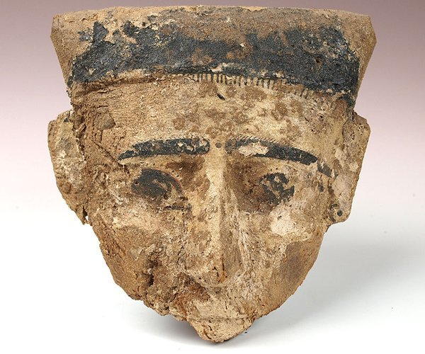 68: An Egyptian Wood and Polychrome Mummy Mask