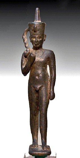 An Egyptian Bronze Figure Of Harpocrates