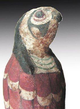 An Egyptian Polychrome Wooden Falcon