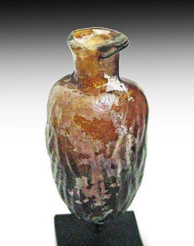 183: A Roman Glass Mold-Blown Amber Date Flask