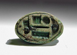 12: An Egyptian Cowroid Faience Amulet