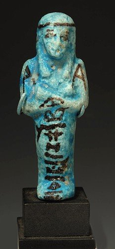 21: An Egyptian Glazed Faience Ushabti for Nes-nakht