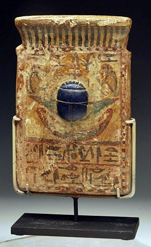 24: An Egyptian Painted Wood Funerary Pectoral