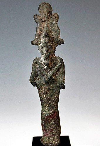 27: An Egyptian Bronze Figure of Osiris