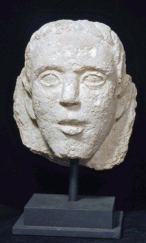 39: A Romano-Egyptian Limestone Male Head