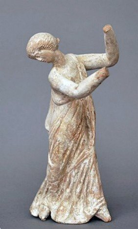 A Greek Pottery Statuette Of A Dancer