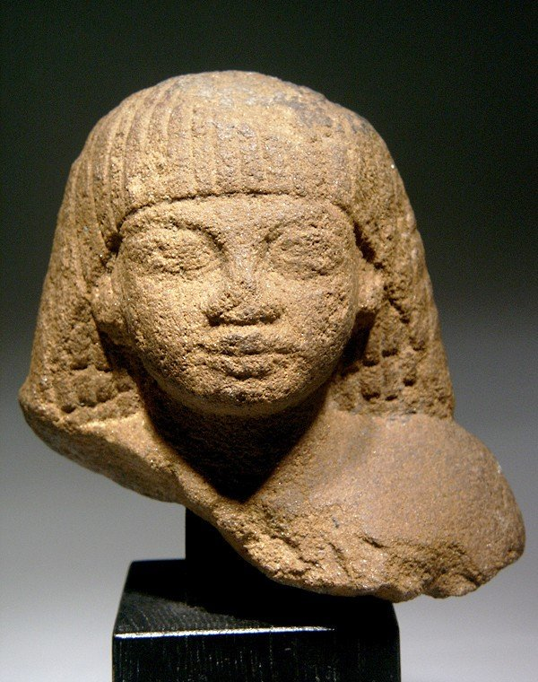 12: An Egyptian Quartzite Bust Reign of Amenhotep III