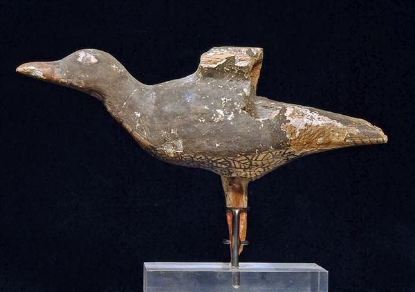 19: An Egyptian Polychrome Painted Wood Bird