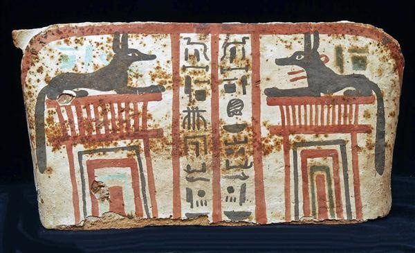22: An Egyptian Wood and Gesso Sarcophagus Panel