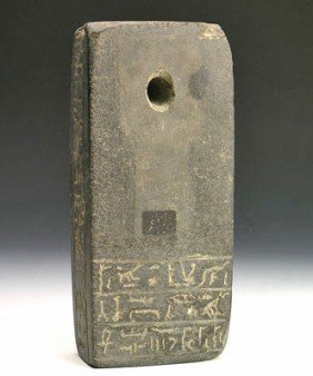 An Egyptian Greywacke Inscribed Base For Isis