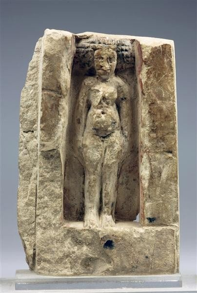 32: An Egyptian Limestone Carving of a Fecundity Idol