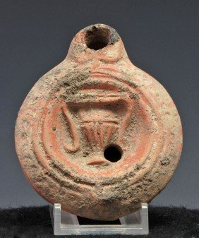 A Roman Redware Lamp With Amphora