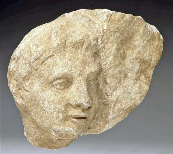 95: A Roman Marble Male Relief Head