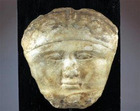 An Egyptian Stone Sarcophagus Mask Of A Male
