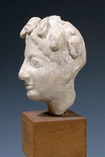 31: A Greek Terracotta Head of a Youth, Archaic Style