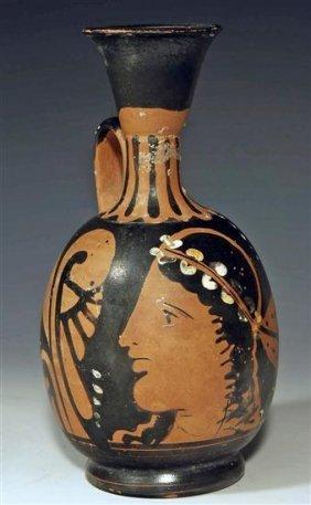 A Greek Paestan Red Figure Squat Lekythos