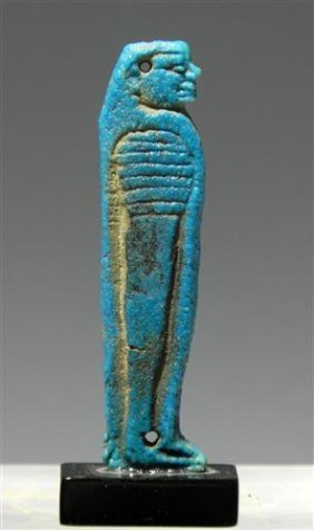 24: An Egyptian Faience Flat Amulet of Son of Horus