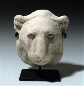 An Egyptian Polychrome Stucco Head Of A Lioness