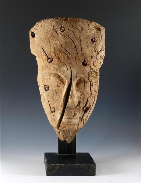 10: An Egyptian Wooden Mummy Mask