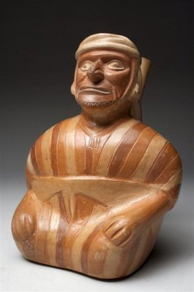 10: A Moche Seated Man in Striped Tunic
