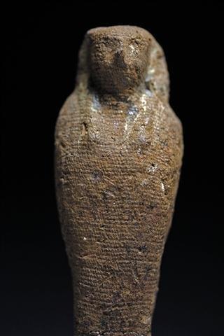 An Egyptian Pseudo-Mummified Horus Figure