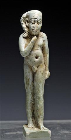 An Egyptian Faience Striding Horus Amulet