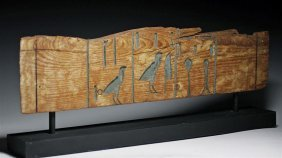 An Egyptian Carved Wood Treasury Chest Panel