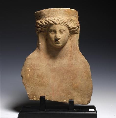 A Greek Terracotta Modeled Female Protome