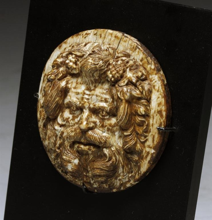 A Roman Ivory Medallion of Bacchus