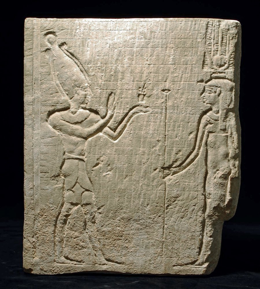 An Egyptian Limestone Carved Relief - Osiris and Isis