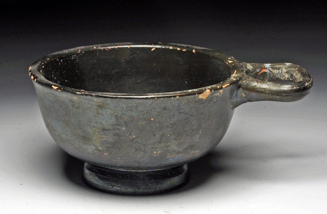 A Greek Blackware Pottery Kyathos