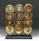 Set of 12 Chimu Gilded Copper Embossed Disks
