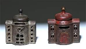Pair of Antique Cast Iron Still Building Banks