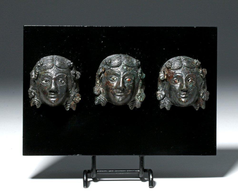 Trio of roman bronze appliques masks maenad heads