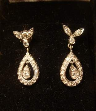 Pair of 14KT White Gold and Diamond Dangle Earrings