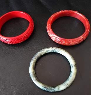 Grouping of Chinese Jade Cinnabar Bracelets