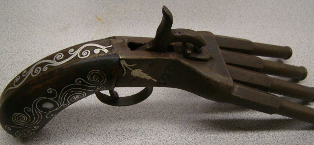 156A: Duck Foot Pistol with Silver Scroll Work