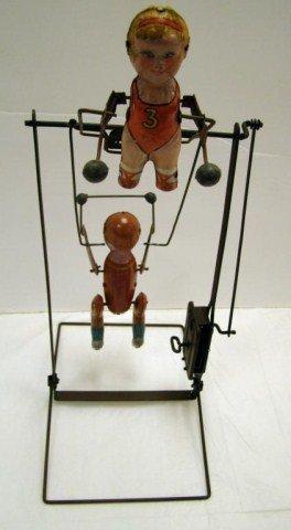 20: Tik-Tak  Key Wind Acrobat Toy