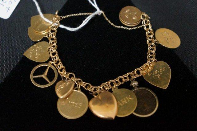 21: 14k Gold Charm Bracelet