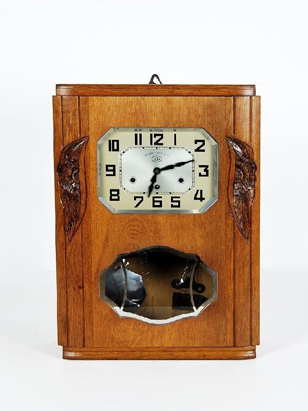 12: Art Deco Walnut Clock Height 23 in; width 16 1/2 in