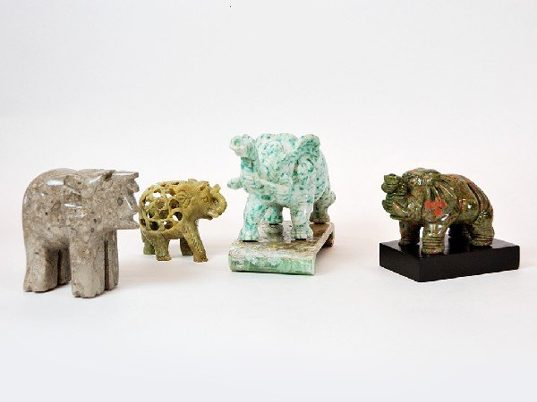 15: Group of Four Carved Stone Elephants Height 5 in; w