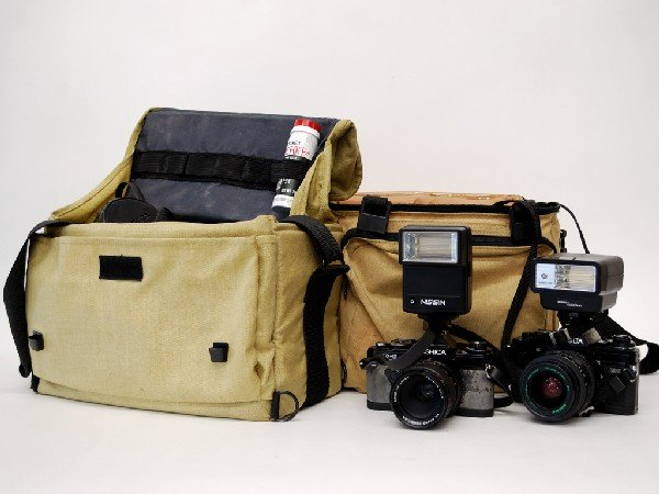 15: Minolta and Yashica SLR Cameras with Travel Cases a