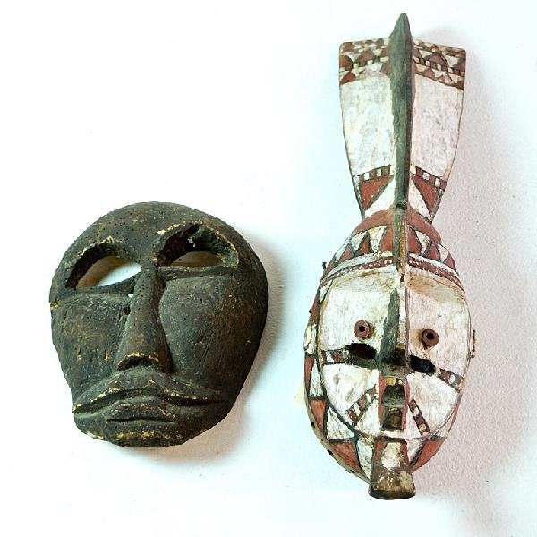 2: Guinea Tribal Mask and an African Monkey Mask