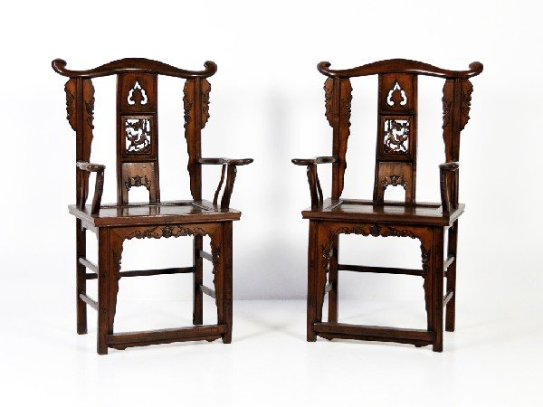 17: A PAIR OF CARVED CHINESE YOKE-BACK ARMCHAIRS Twenti