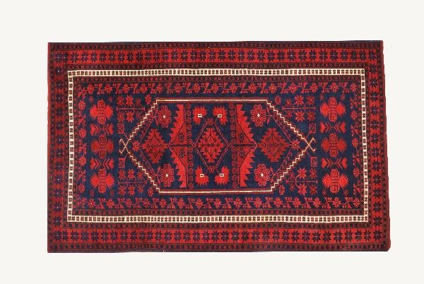 1: A PERSIAN BALOUCHI CARPET