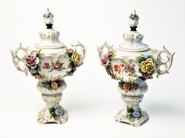 12: A PAIR OF GERMAN PORCELAIN COVERED URNS Nineteenth