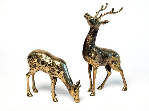 17: A PAIR OF BRASS DEER