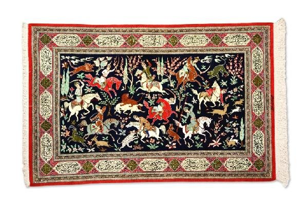 "19: A HORIZONTAL ""HUNTING SCENE"" QUM CARPET, Central Pe"