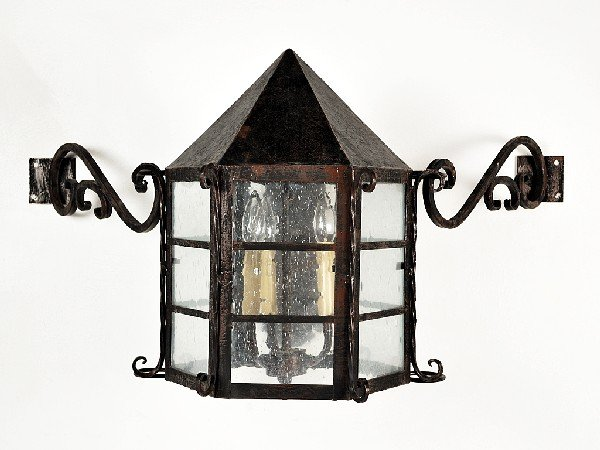 12: A DECORATIVE IRON WALL SCONCE
